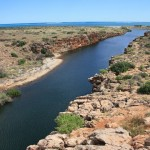 Yardie Creek flowing into the Indian Ocean