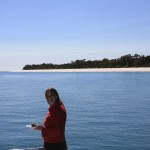 Cutie with morning tea, Fraser Island in the background